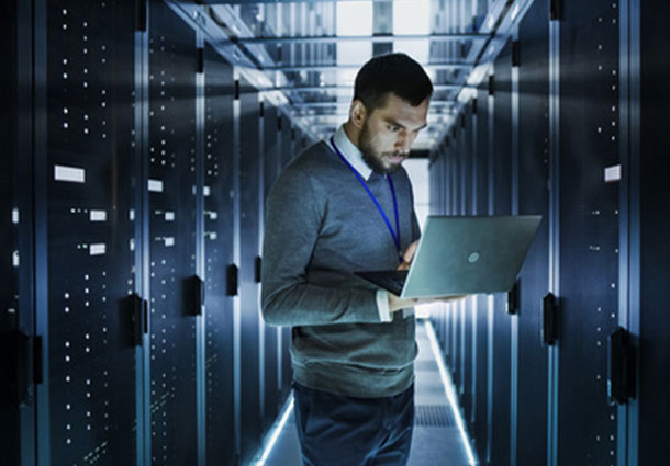 Man in a data center working on servers